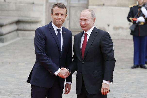 French President Emmanuel Macron shakes hand with Russian President Vladimir Putin at Palace of Versailles, in Versailles, France on May 29th, 2017. Photo by Henri Szwarc/ABACAPRESS.COM